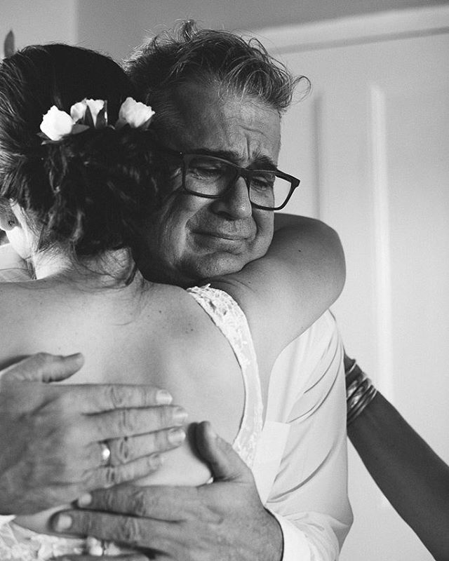 Father seeing his daughter in her wedding dress for thehellip